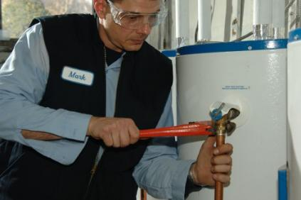 Coppell plumbing contractor repairs a water heater intake line